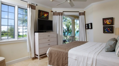 Master bedroom with patio doors leading to balcony