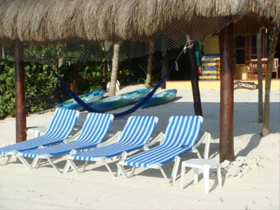 Palapa with beachchairs just for our guests