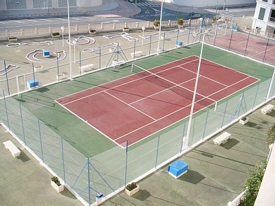 Outdoor sporting facilities including tennis court