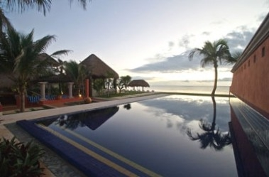 Overlooking the infinity pool to the beach.