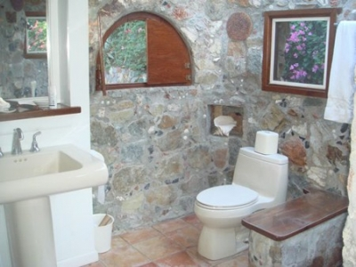 Master bath with hand-crafted stone walls.