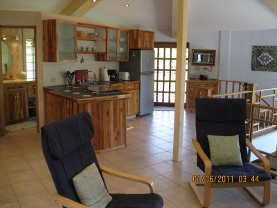 Living area with door to upstairs deck