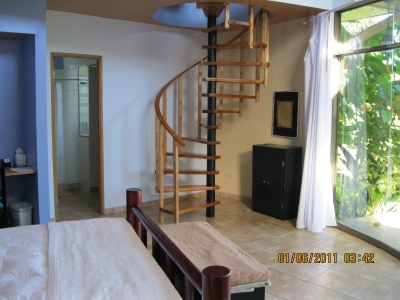 Spiral stair from upstairs to downstairs bedroom